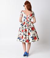 Unique Vintage 1950s Style Beige & Floral Short Sleeve Draper Swing Dress