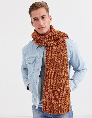ASOS DESIGN knitted scarf in burnt orange twist