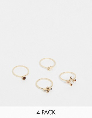 Pieces 4 pack rings with stones in gold