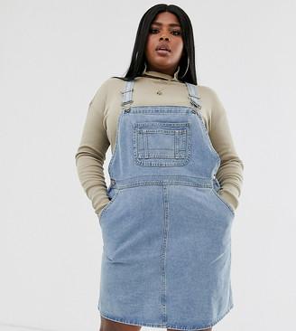 Asos DESIGN Curve denim overall dress in vintage blue