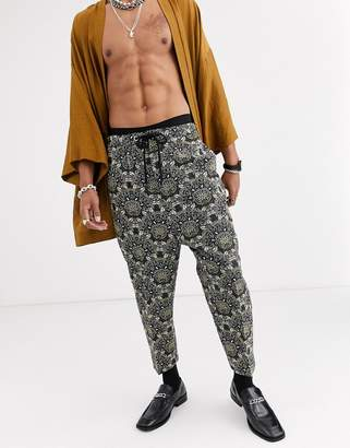 Asos Design DESIGN drop crotch tapered smart trousers in green floral jacquard with drawcord waist