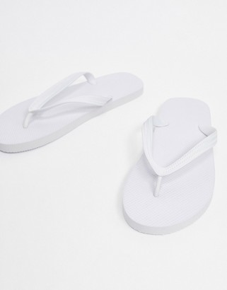 ASOS DESIGN flip flops in white