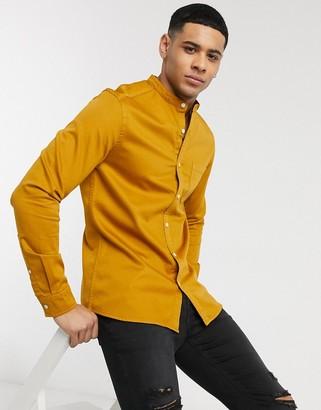 Asos DESIGN stretch slim organic denim shirt with grandad collar in mustard