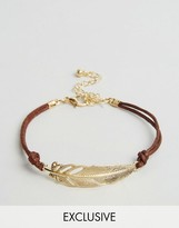 Reclaimed Vintage Feather String Bracelet In Gold