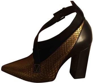 Louis Vuitton Matchmake Gold Python Heels