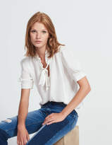 Silk top with frilled collar and tie