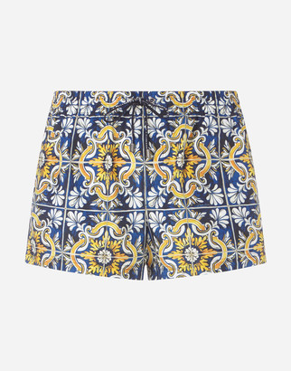 Dolce & Gabbana Short Swimming Trunks With Maiolica Print On A Blue Background