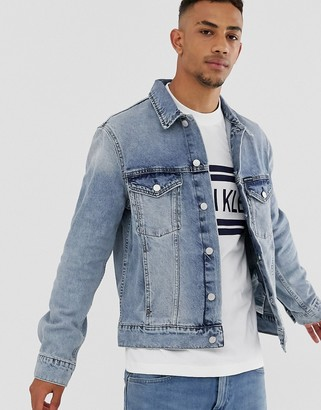 Calvin Klein Jeans denim trucker jacket in mid wash