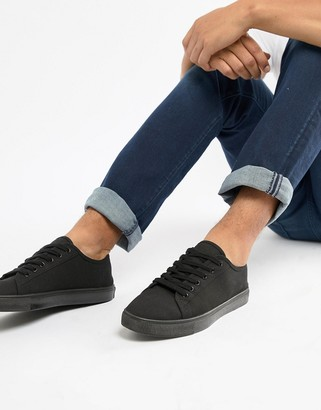 Asos DESIGN sneakers in black canvas