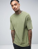 Asos Oversized T-Shirt With Grown On Sleeve And Rib Extension In Green Wash