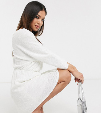 Club L London Petite sequin plunge neck long sleeve mini dress in white