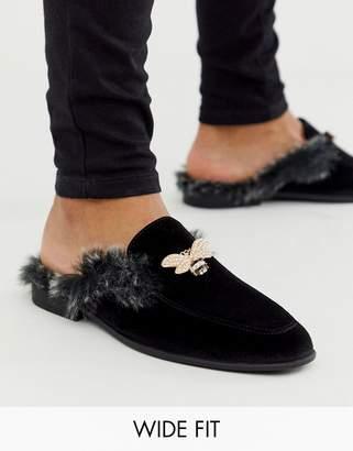 Asos Design DESIGN Wide Fit backless mule loafer in black velvet with faux fur insock and hardware detail