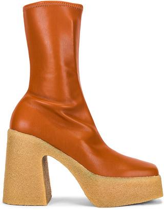 Stella McCartney Skyla Stretch Boots in Praline | FWRD
