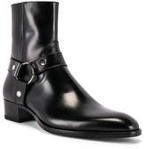 Saint Laurent Wyatt Leather Harness Boots in Black | FWRD