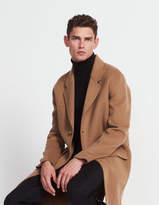 Long, fluid three-button coat
