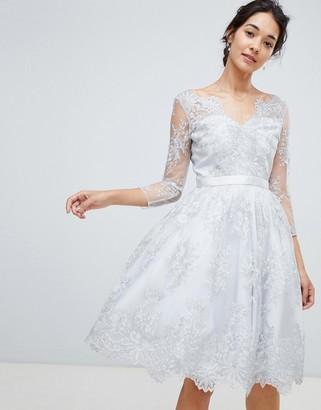 Chi Chi London premium lace scalloped neck midi dress in silver