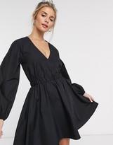 Asos Design DESIGN v neck cotton poplin elasticated waist mini dress in black