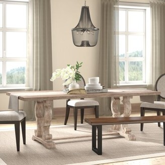 Ophelia Esita Extendable Solid Wood Dining Table & Co.