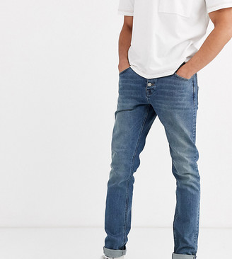Asos DESIGN Tall slim jeans with exposed button fly in vintage mid wash