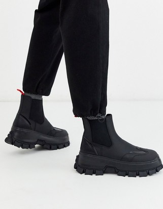 Asos DESIGN chelsea boots in black with strapping details and chunky cleated sole