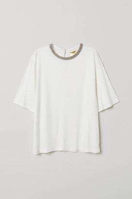 H&M Top with beaded appliques