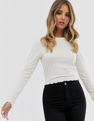 New Look long sleeve crop frill hem top in off white-Cream