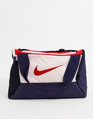 Nike small sports bag in navy and pink