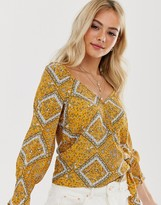 Pimkie printed wrap blouse in yellow