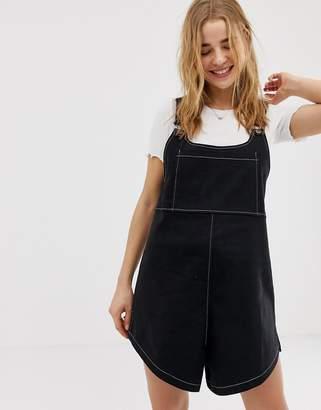Asos Design DESIGN contrast stitch dungaree playsuit-Black
