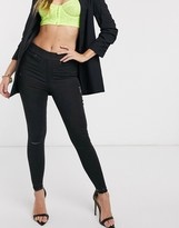 Spanx high waist coverage and Slim Built In in distressed skinny jean in black