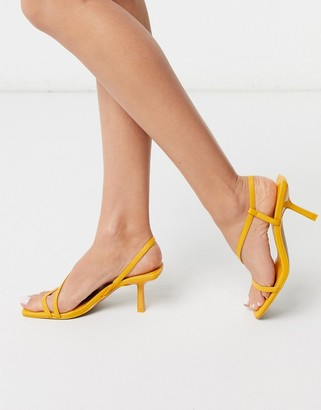 ASOS DESIGN Hammond strappy mid-heeled sandals in yellow