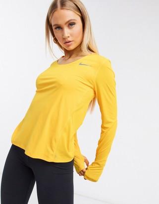 Nike Running city sleek long sleeve top in yellow