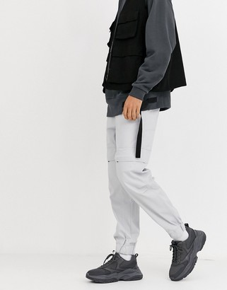 Asos DESIGN oversized tapered trousers with concealed pockets in grey