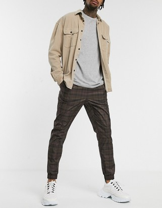 Asos DESIGN tapered sweatpants in brown check with webbed belt