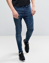Religion Drop Crotch Skinny Jeans With Biker Knee Detail And Zip Ankle In Dark Wash Blue