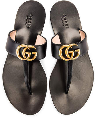 Gucci Double G Leather Thong Sandals in Black | FWRD