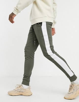 ASOS DESIGN skinny joggers with side stripe in khaki