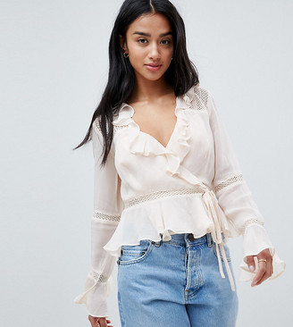 Asos DESIGN Petite wrap long sleeve top with ruffle and lace insert in cream