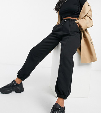 ASOS DESIGN Petite oversized jogger with pintuck in black