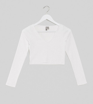 ASOS DESIGN Petite notch front long sleeve crop top in rib in white