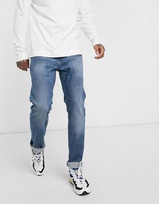 Edwin ED80 slim fit jeans in washed blue denim