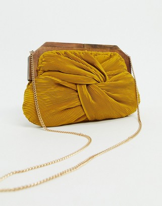Accessorize knotted wood frame clutch bag in mustard