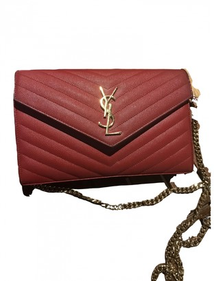 Saint Laurent Portefeuille enveloppe Red Leather Clutch bags