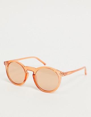 ASOS DESIGN round plastic sunglasses in orange