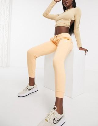Nike essentials slim joggers in orange