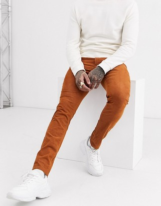 Topman skinny cord trousers in rust