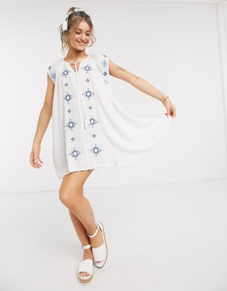 En Creme embroidered detail a line dress in white