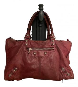 Balenciaga Weekender Burgundy Leather Handbags