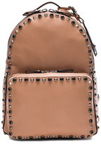Valentino Guitar Rockstud Rolling Medium Backpack in Neutrals.