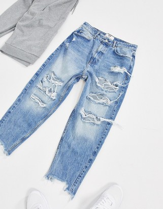 Bershka loose jeans with rips in blue